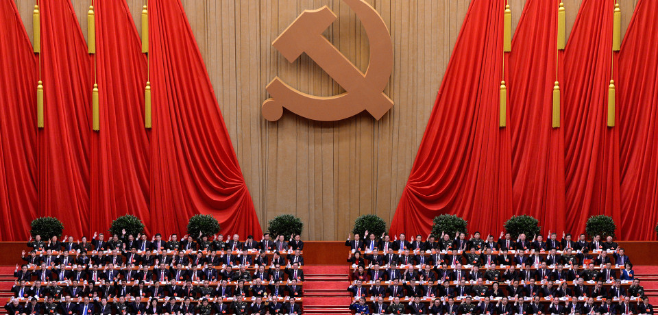 Chinese President Hu Jintao (Centre L) and former President Jiang Zemin (Centre R)  with members of the Presidium raise the hands during the closing ceremony of the Party Congress at the Great Hall of the People in Beijing on November 14, 2012.  China's Communist Party will on November 15 unveil the new set of top leaders who will run the country for the next decade, one day after its week-long congress ends.        AFP PHOTO/Mark RALSTON        (Photo credit should read MARK RALSTON/AFP/Getty Images)