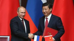 SHANGHAI, CHINA - MAY 20: Russian President Vladimir Putin (L) and Chinese President Xi Jingping (R) attend a welcoming ceremony on May 20, 2014 in Shanghai, China. Putin is on a two day visit to China (Photo by Sasha Mordovets/Getty Images)